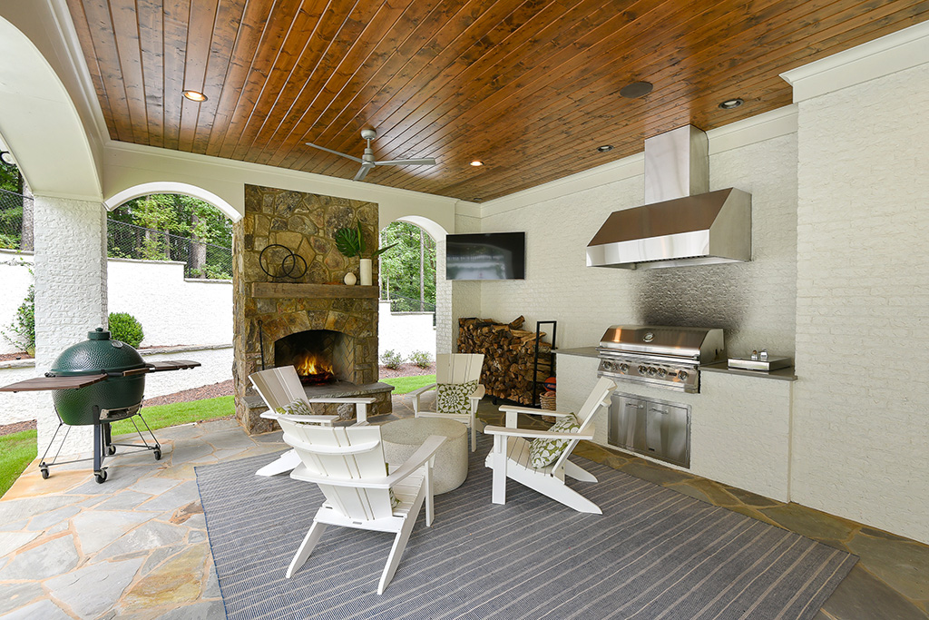 Marietta Custom Home Farmhouse Covered Patio fireplace, seating, and outdoor kitchen