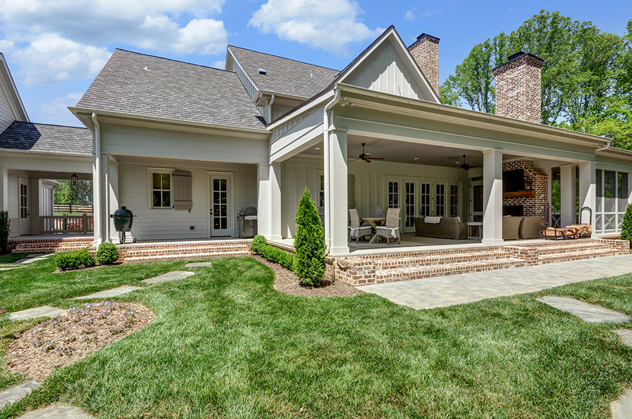 Modern Farmhouse view of covered patio from yard