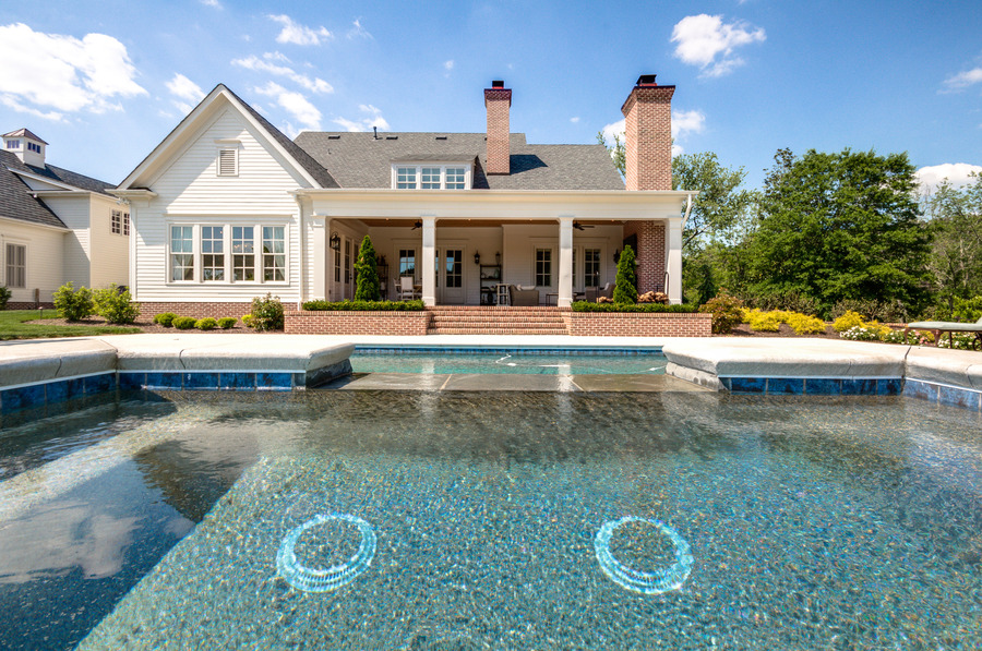 Farmhouse Back of house with pool view
