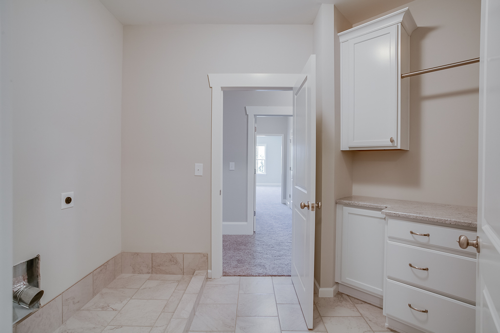 Laundry Room connected to Master Closet