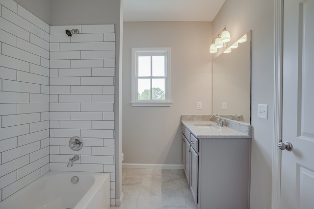 upper level bathroom connected to 15 x 13 bedroom